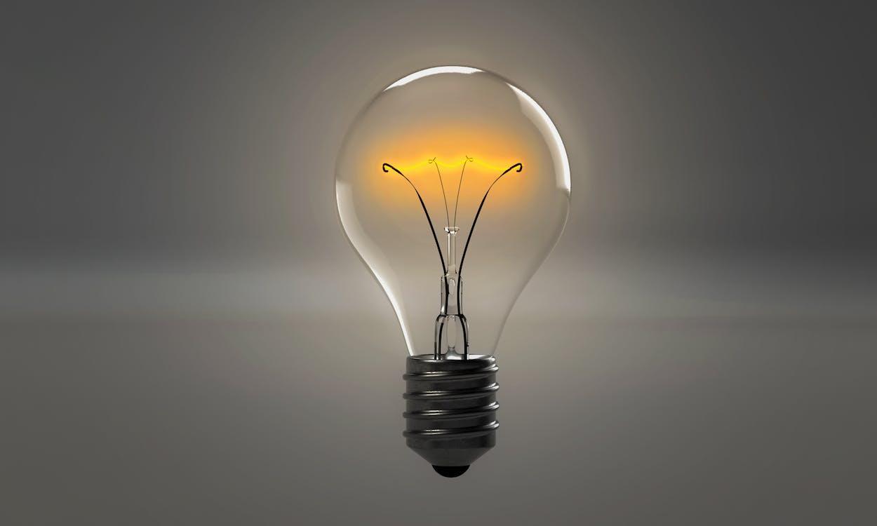 Illuminated Light Bulb Reflection