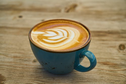 Close-Up Photo of Coffee on Teal Ceramic Cup