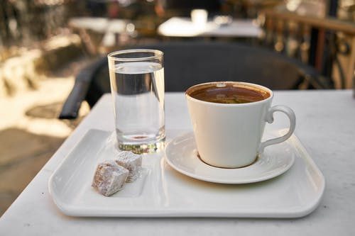 White Ceramic Coffee Mug and Drinking Glass on Tray