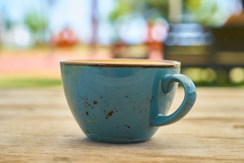Close-Up Photo of Teal Ceramic Cup