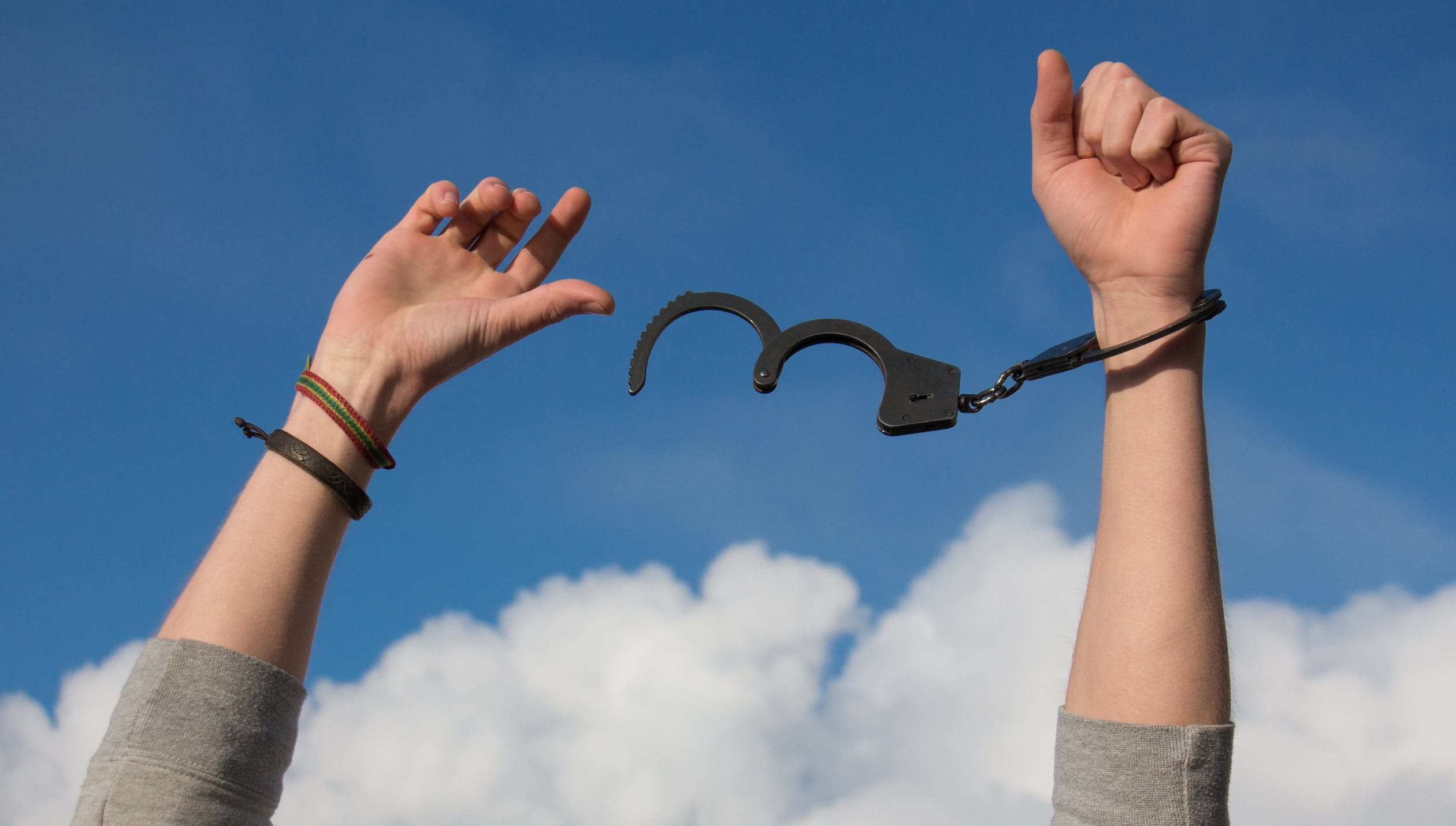 A person out of handcuffs - free to do other things, which is one of the reasons for outsourcing logistics