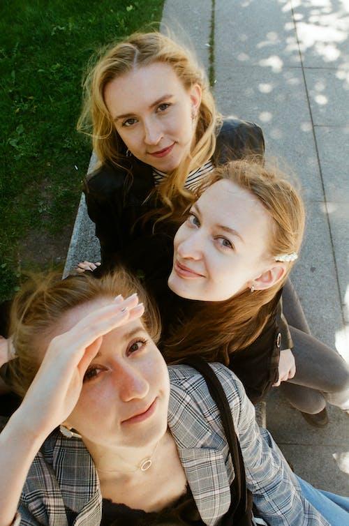 Three Women Near Grass