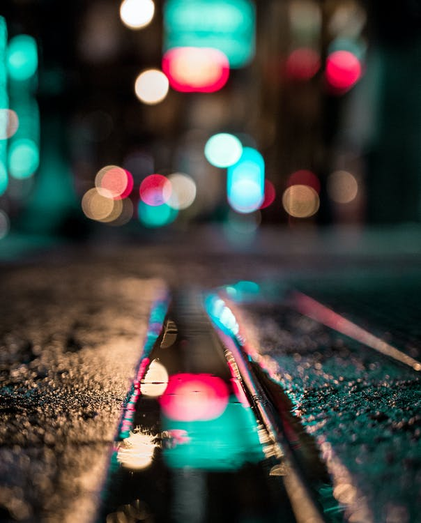 Selective Focus Photo of Wet Ground