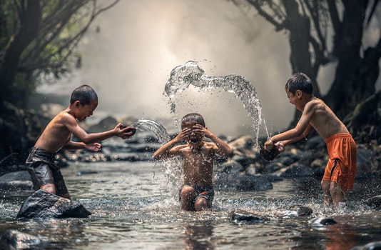 Group of People Splashing Water