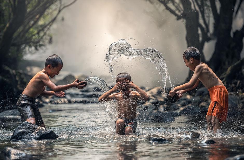Group of People Splashing Water