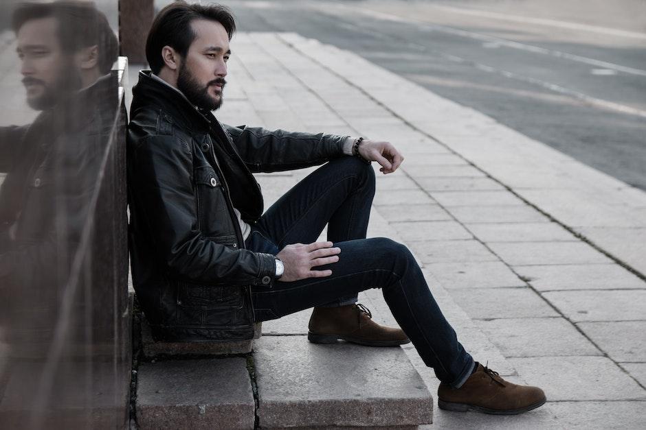 Full Length of Man Sitting in City