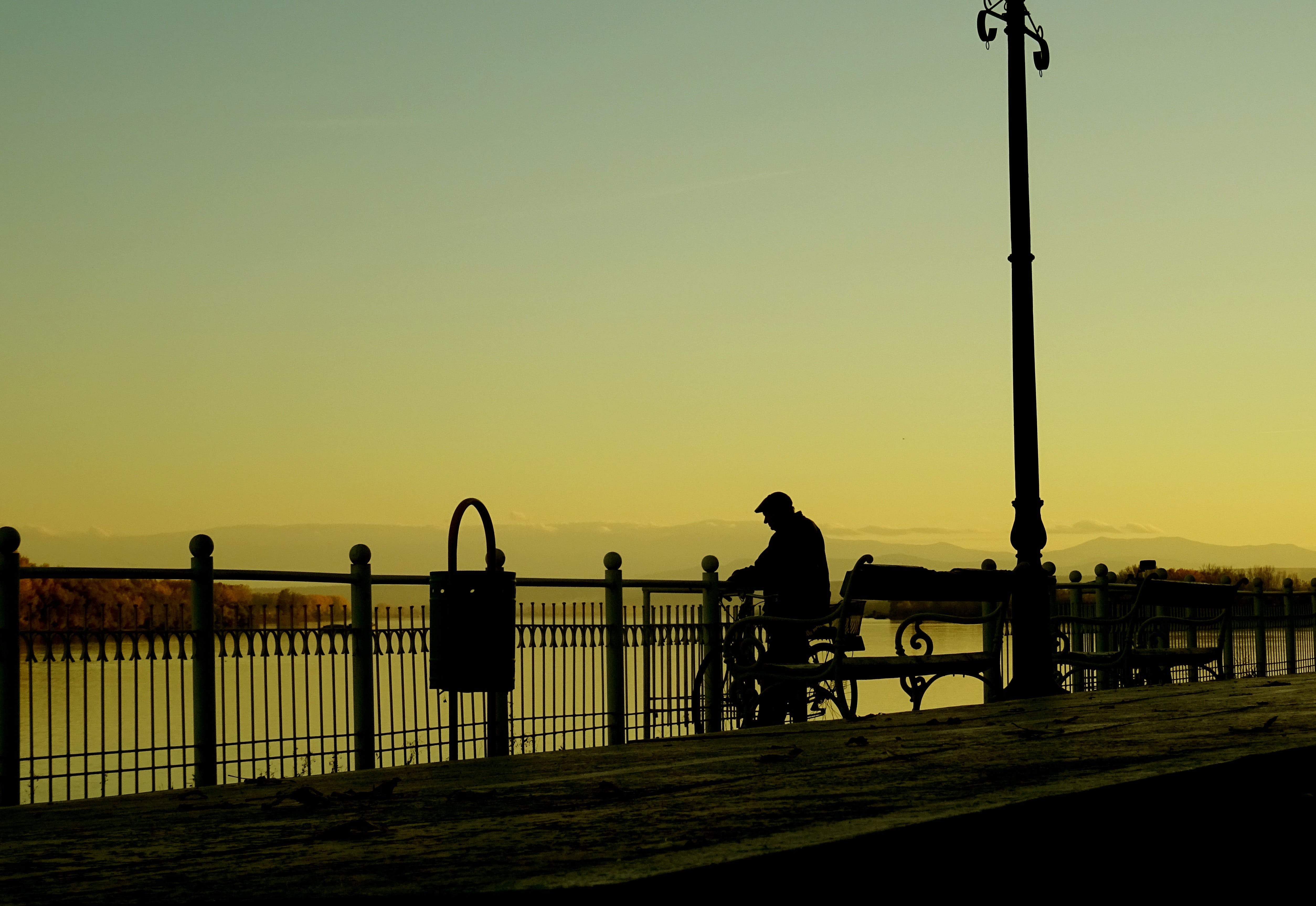 Silhouette Man on Street in City at Sunset