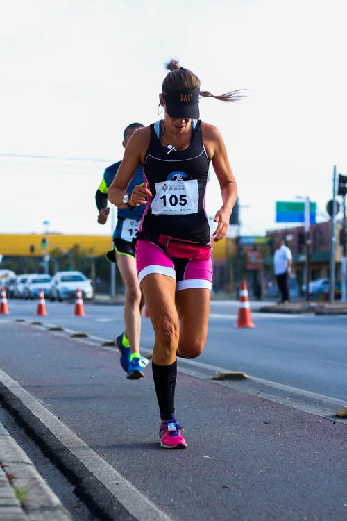 Photo of Woman Running on Road