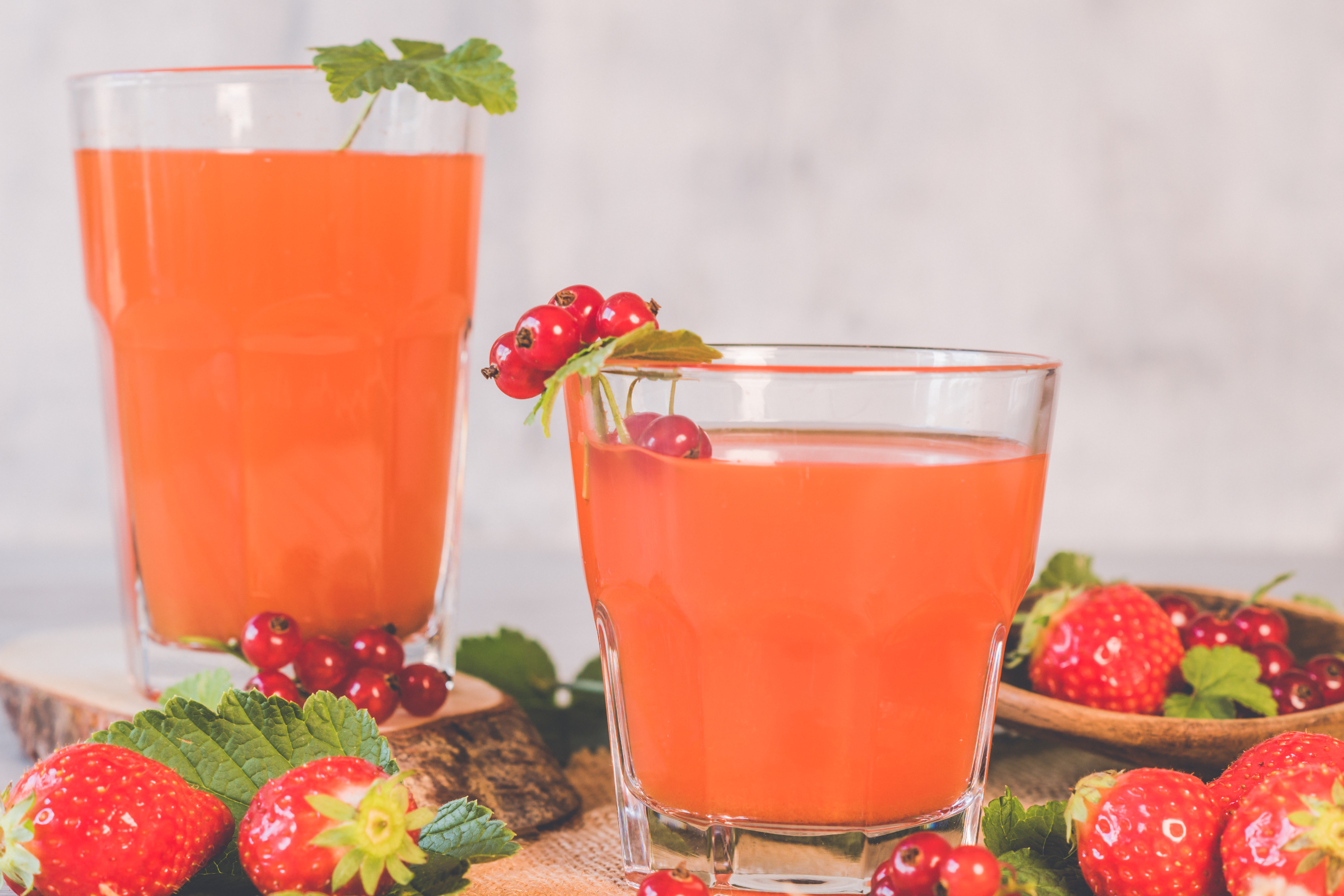 Two Clear Drinking Glasses With Strawberry Juice