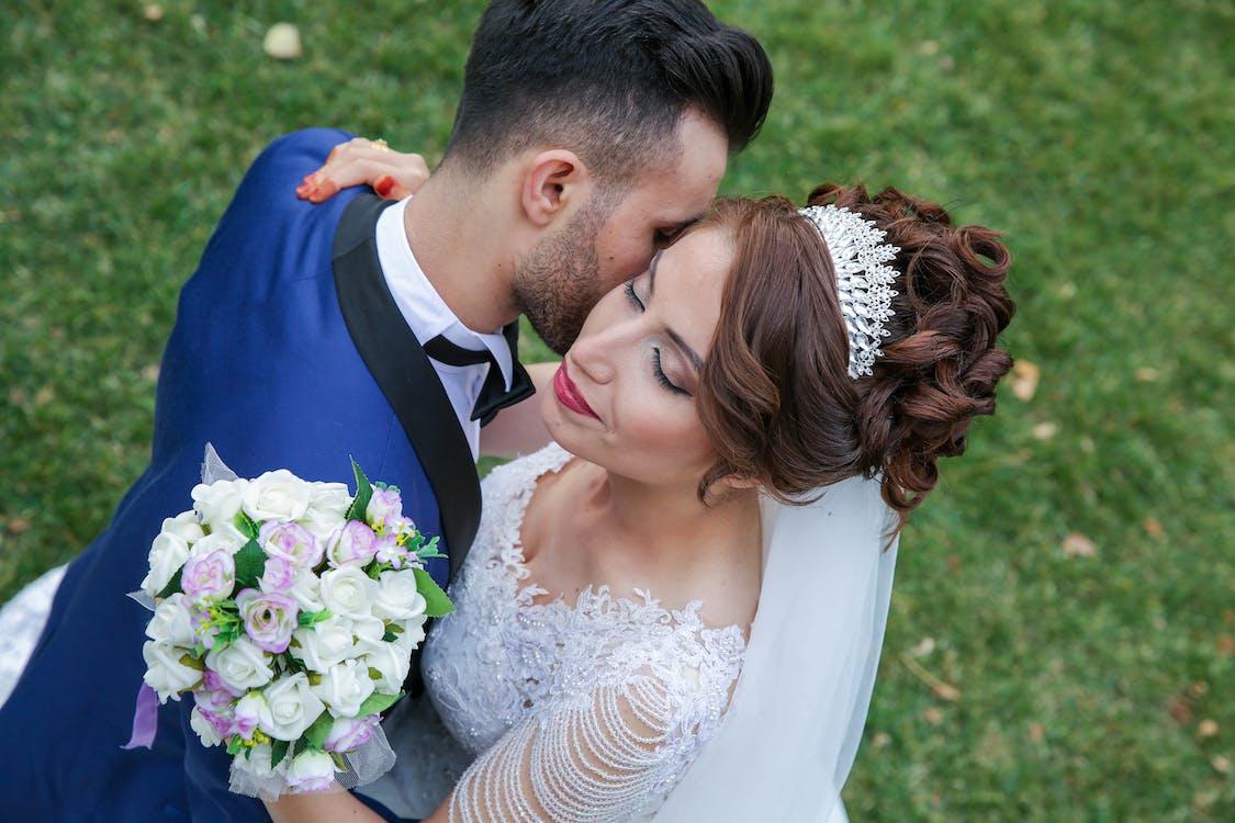 Happy Couple Holding Flower