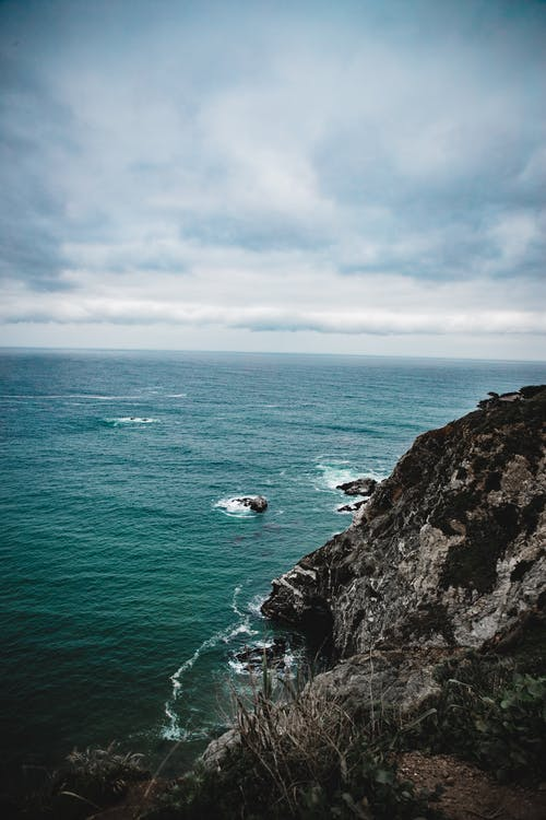 Foto profissional grátis de abismo, água, ao ar livre, beira-mar