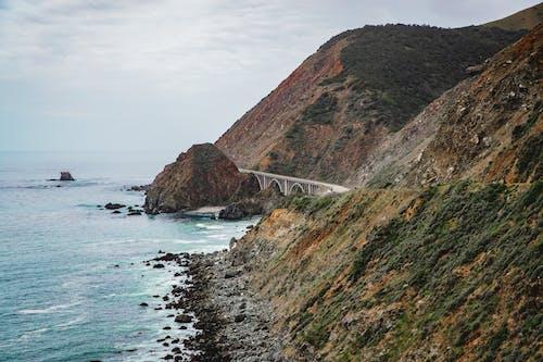 Gratis stockfoto met baai, berg, brug, buiten