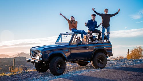 Photo of people on pickup truck