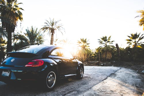 Black Volkswagen New Beetle on Road