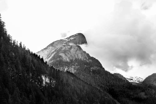 Grayscale photography of a snow covered mountain