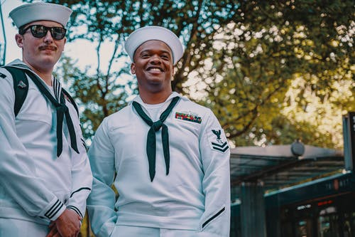Two Men Wearing Sailor Uniforms