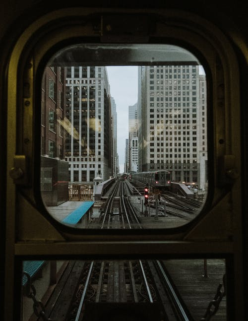 Window Train Overlooking Buildings