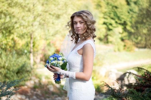 Portrait of a Beautiful Woman Holding Flower