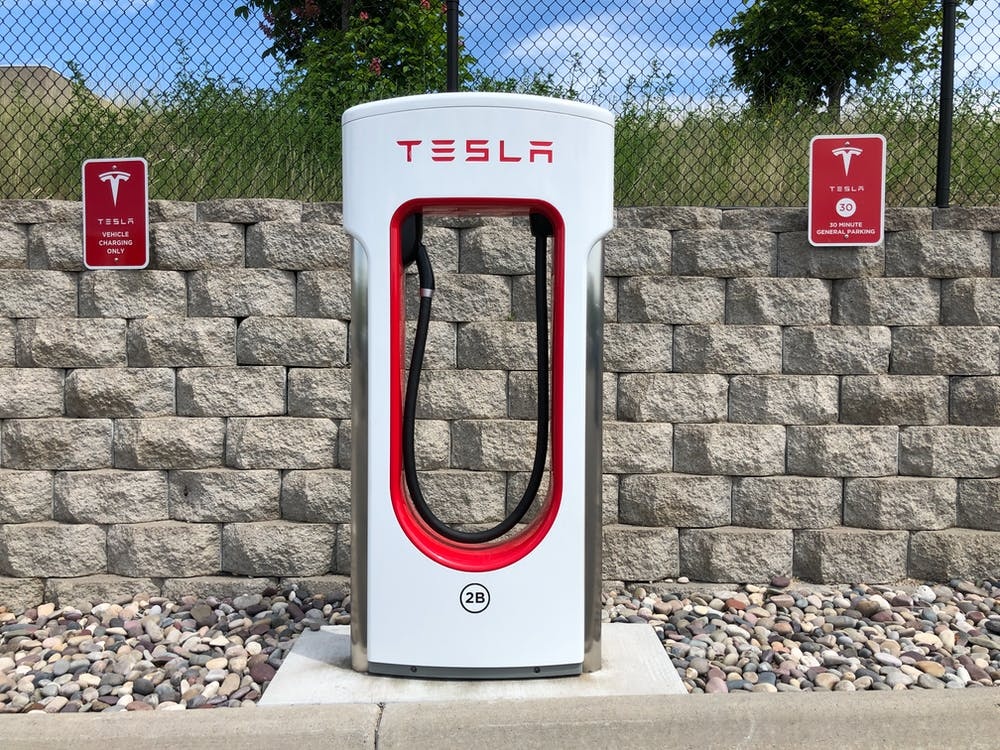 Free stock photo of electric car, electric car charger, electric car charging station