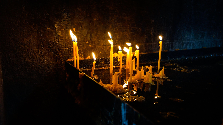 Lit Candles in Darkroom