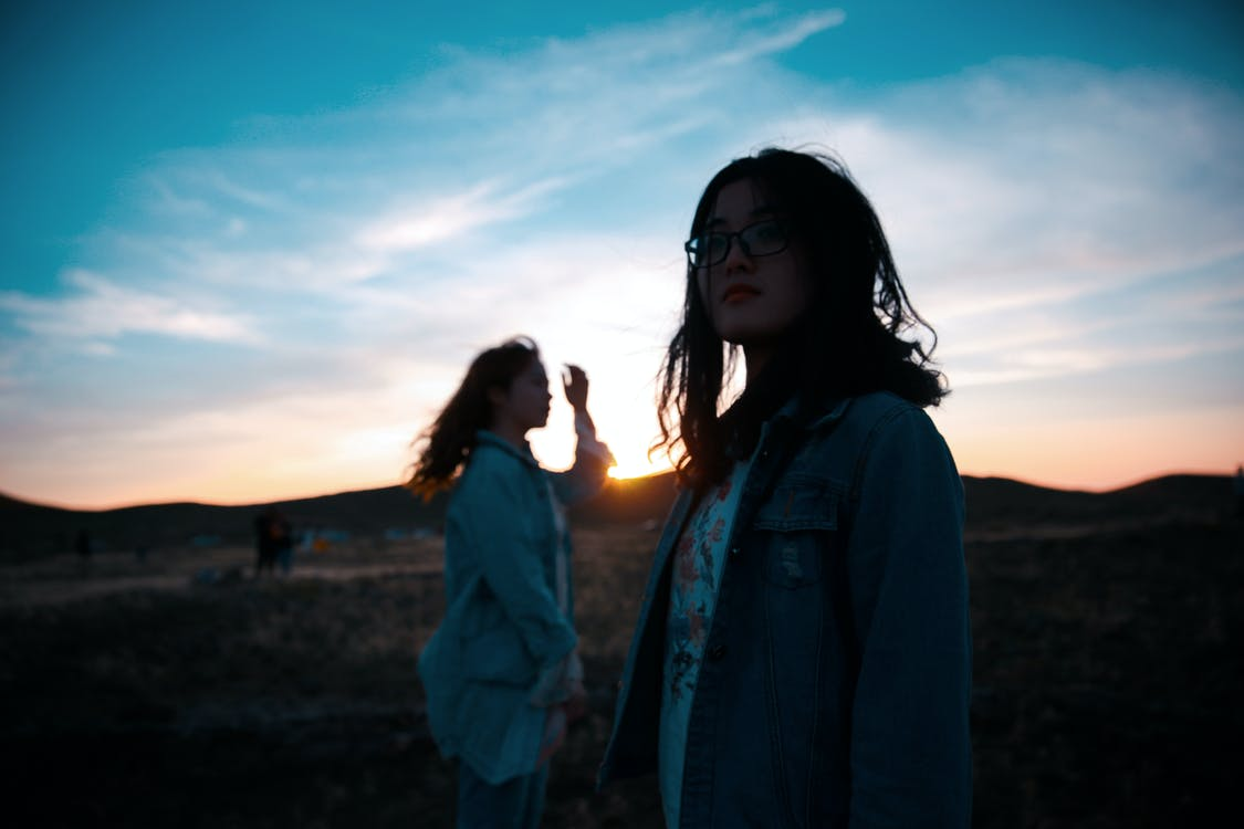 Women Standing on Mountain during Sunset