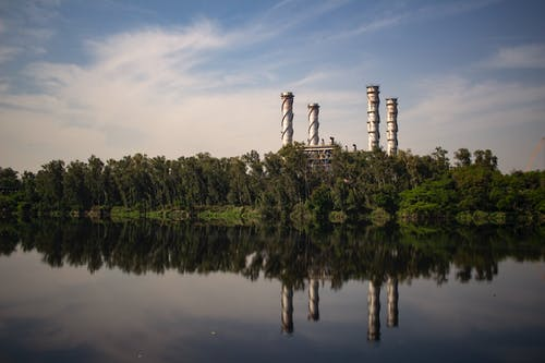 Industrial Plant With Reflection Om Body Of Water