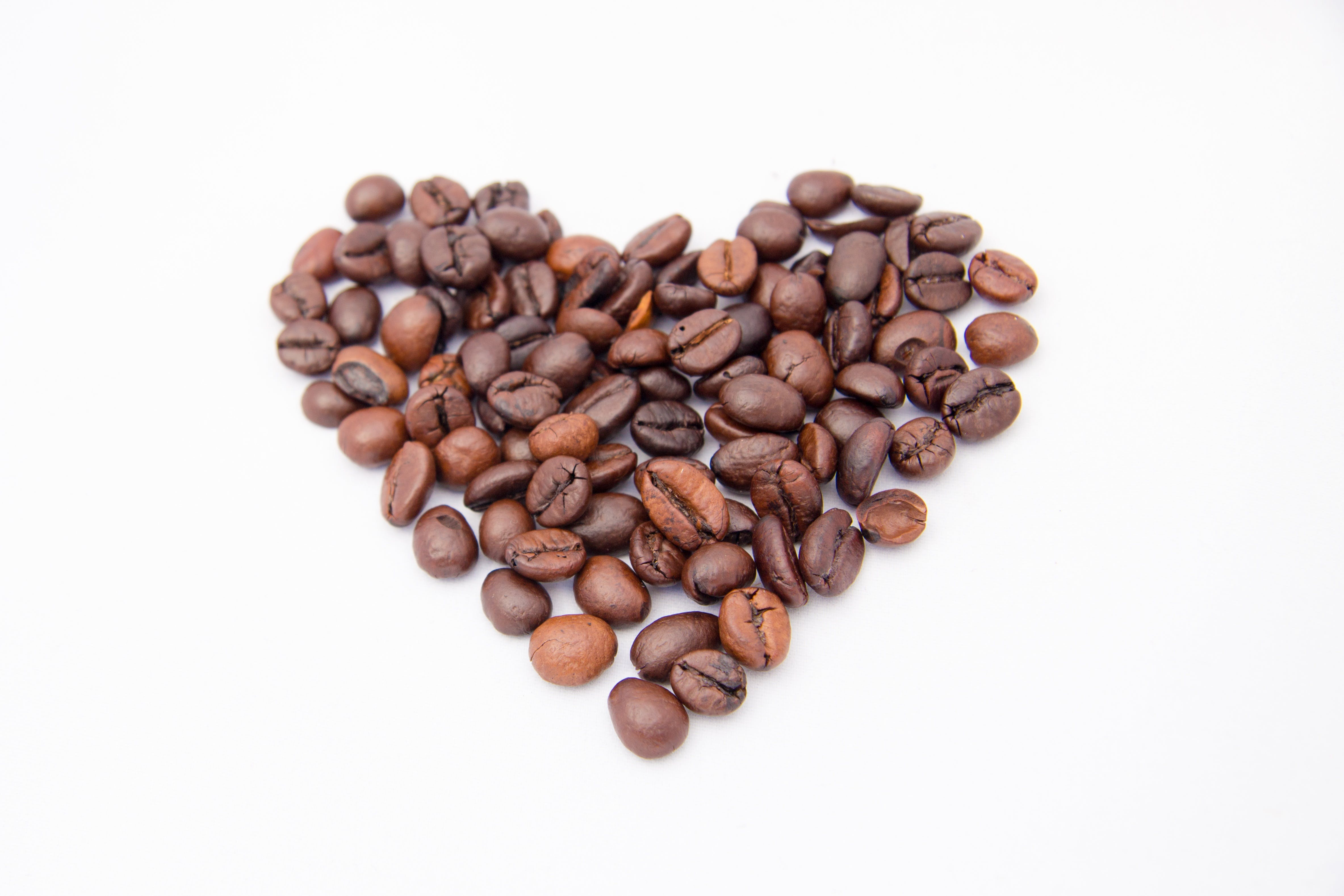 Close-up of Coffee Beans on White Background