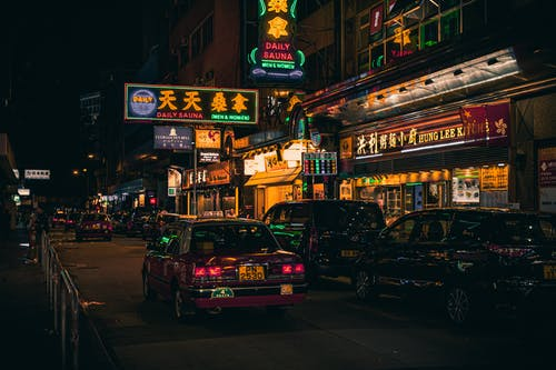 Cars Beside Neon Signages