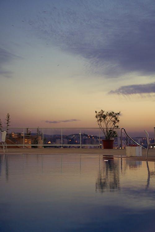 Kostenloses Stock Foto zu bokeh, himmel, pool, rosa himmel
