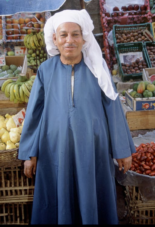 Man Standing in Front of Fruits