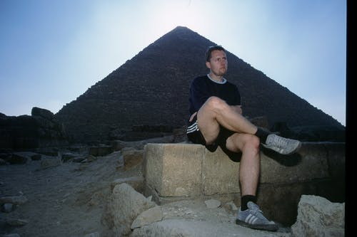 Man Wearing Black Shirt Across Pyramid