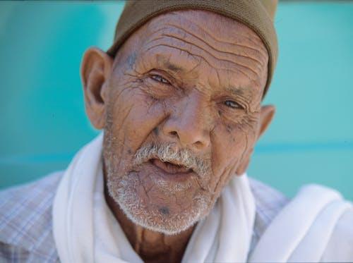 Portrait Photo of Elderly Man in White Scarf