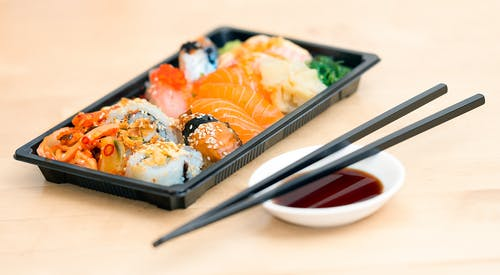 Close-up Photo of Sushi Served on Table