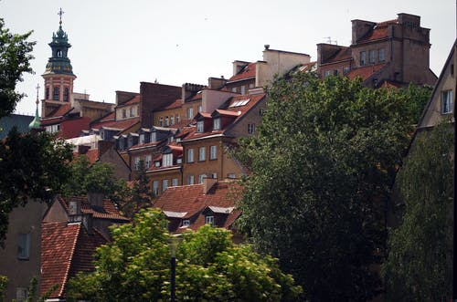 Houses With Red Brick Roofs Near Church