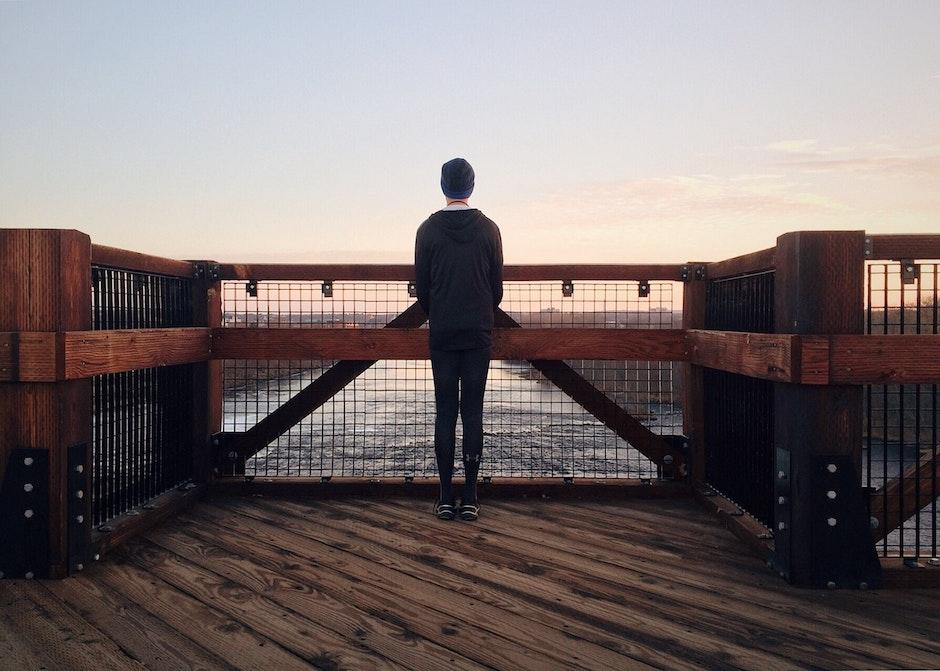 Rear View of a Man Walking on Beach