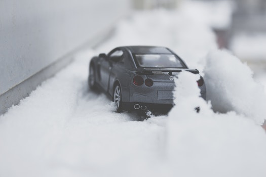 Close-up Photo of Toy Car on Snow