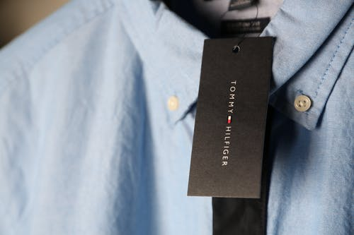 Close-up Photo of Blue Tommy Hilfiger Dress Shirt With Tag