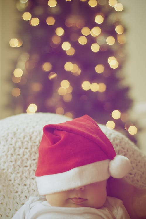 Close Up Of Illuminated Christmas Tree And A Baby 183 Free