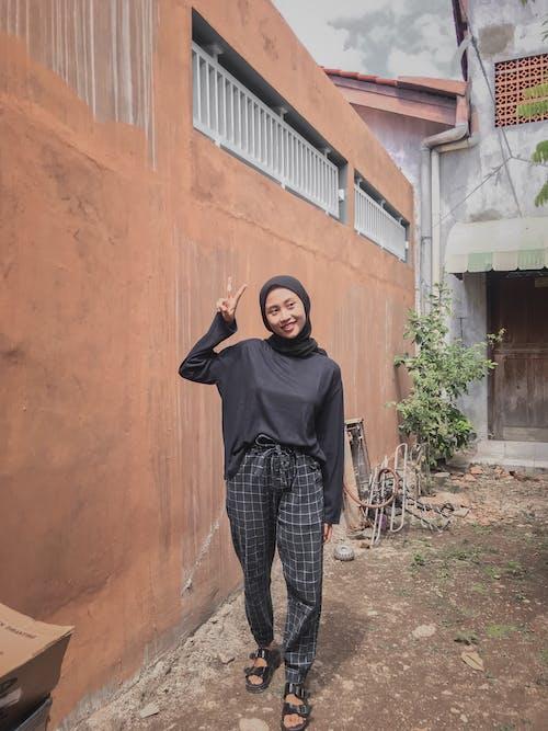Woman Wearing Black Hijab Doing Peace Sign