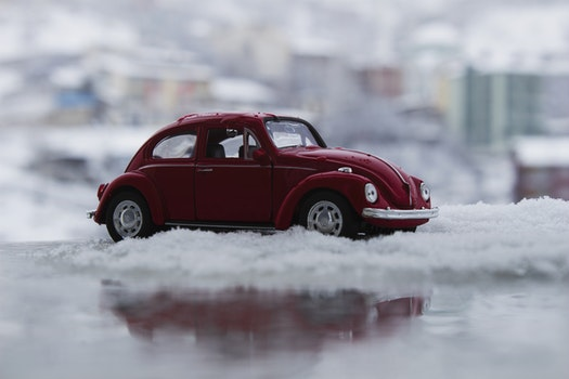 Red Toy Car in Snow
