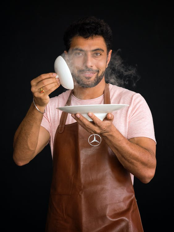 Man Holding White Plate