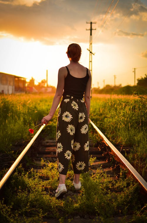 Woman Standing On Railroad