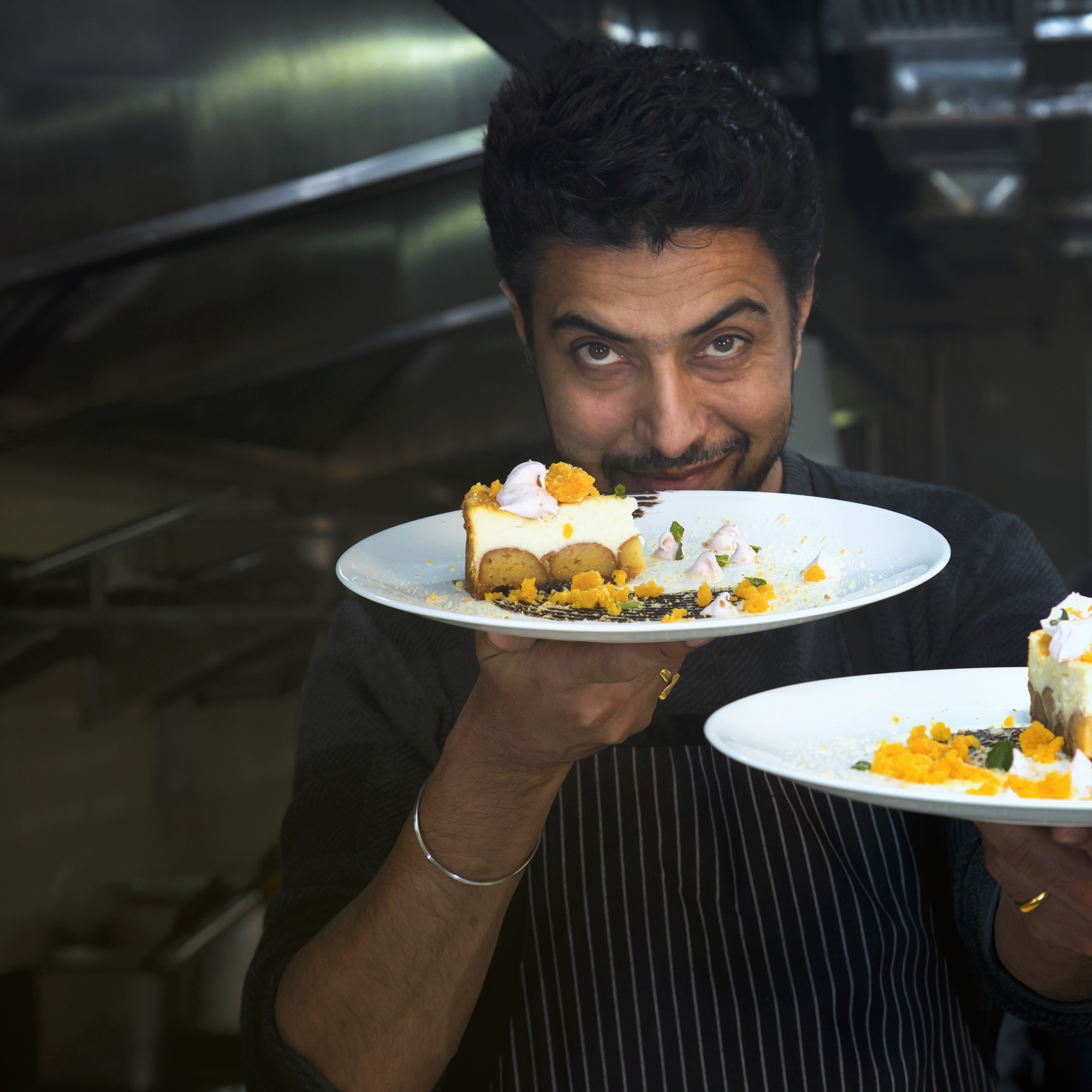 Man Holding Two Plates With Cooked Foods