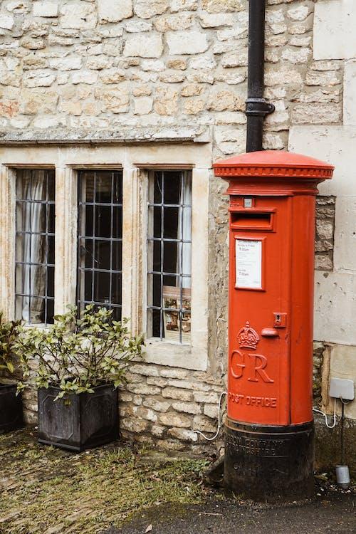 Red Mailbox Beside Window