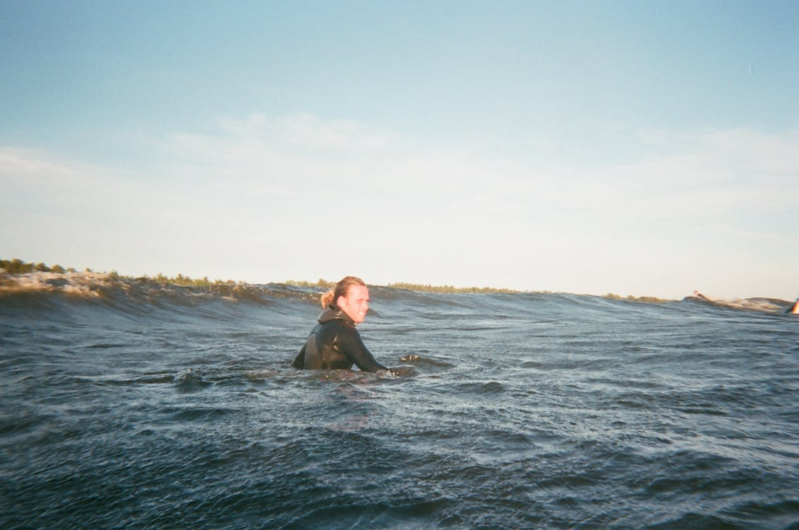 Person Swimming in a Body of Water