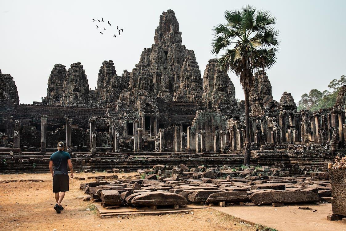 Man Looking At An Ancient Temple
