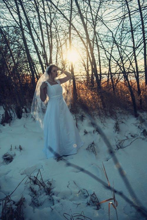 Women Wearing Wedding Gown