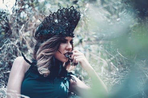 Woman Wearing Green Crown