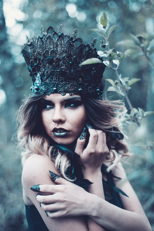 Women Wearing a Black Crown Close-up Photography