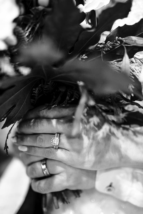 Grayscale Photography of Person Wearing Bouquet